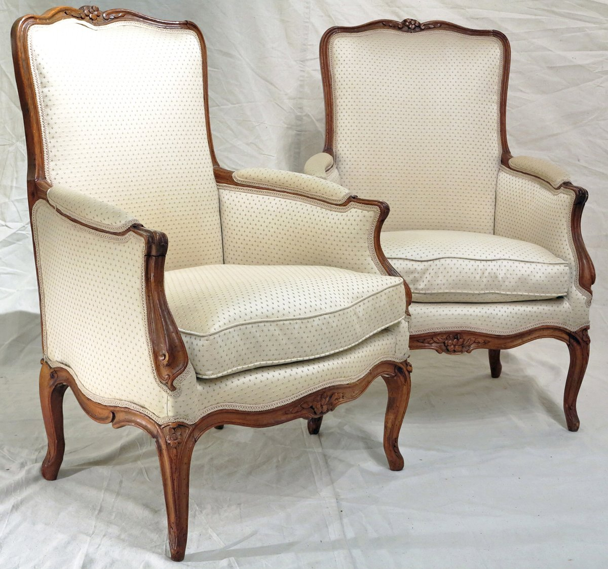 A Pair of Louis XV  Carved Beechwood Bergeres Attributed to Nicolas Blanchard, maitre in 1771